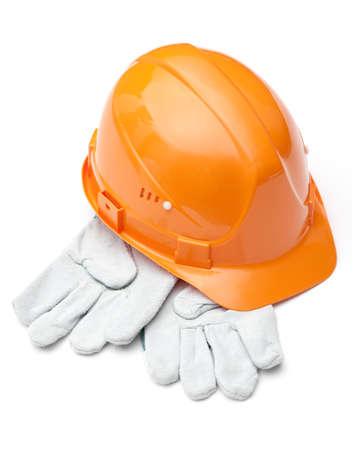 hard stuff: Orange hard hat on white gloves, isolated on white