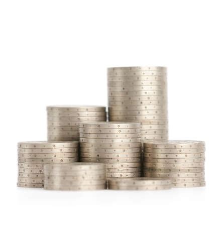 Silver coins stand vertically in low columns, isolated on white  Symmetrically posed coins symbolise weath, richness, income and profit  Close up shot  photo