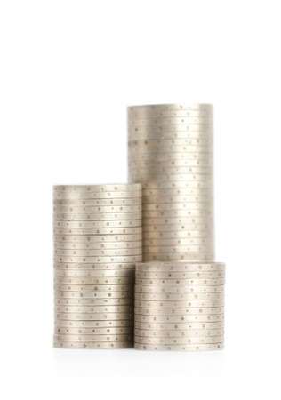 Silver coins are up vertically in columns, isolated on white. Symmetrically posed coins symbolize wealth, richness, income and profit. Close up shot. photo