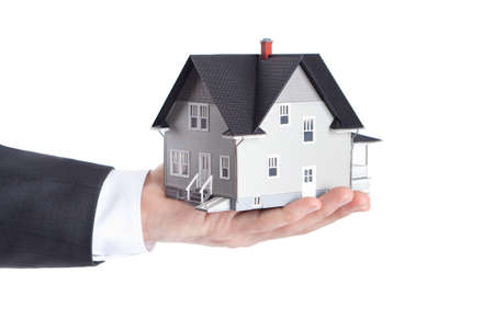 realty residence: Realty concept - hand holding house architectural model, isolated