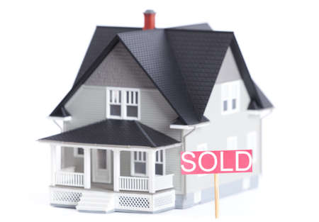 Real estate concept - household architectural model with Sold sign, isolated Stock Photo - 14661101