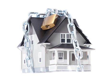locking up: Real estate concept - chain with lock around the house architectural model, isolated