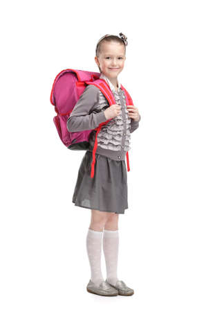 Self-disciplined pupil is ready to go to school, isolated, white background photo