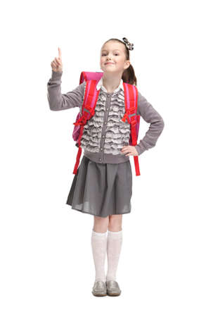 Self-confident pupil is ready to go to school, isolated, white background photo