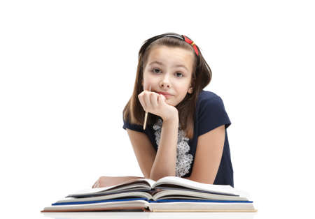School girl is waiting for inspiration to start writing, isolated, white background photo