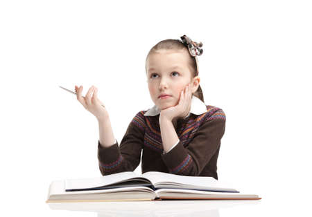 Schoolgirl thinks over the essay, isolated, white background photo