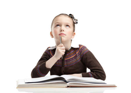difficult task: Schoolgirl thinks over the difficult task, isolated, white background