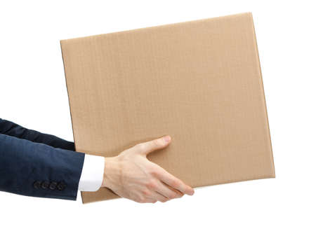 Shop assistant gives the parcel, isolated, white background Stock Photo - 14661156
