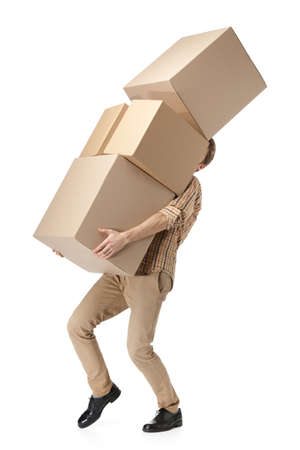 carry: Man hardly carries the cardboard boxes, isolated, white background