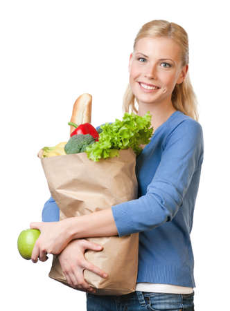Attractive woman with a paper bag full of healthy eating, isolated on white photo