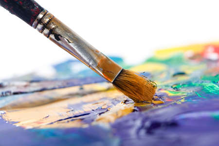 close in: Painting some picture with paintbrush, isolated on white background