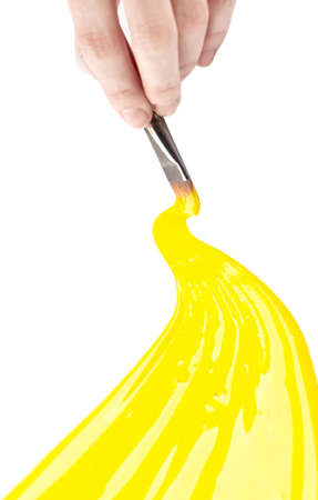 Hand draws yellow curve line on white, isolated photo