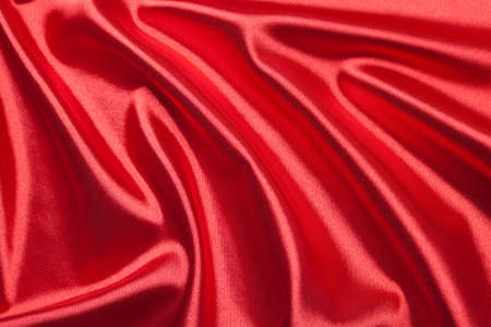 Smooth red silk or satin background photo