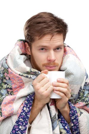achy: Sick young man holding cup of tea, isolated Stock Photo
