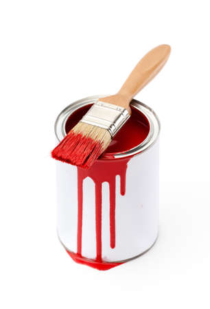 Full of red paint tin and paint brush which is dirty with red ink, isolated on white background photo