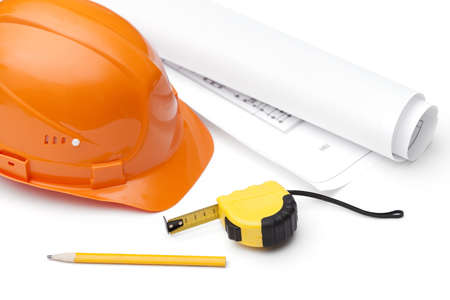 hard stuff: Orange hard hat, druft, pencil and tape measure, isolated on white