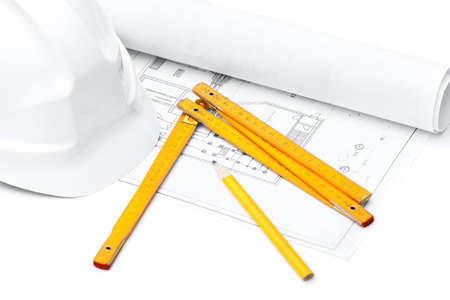 hard stuff: White hard hat, foot ruler and pencil on the druft, isolated on white background Stock Photo
