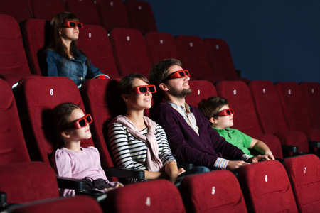 three dimensional: Young family watching a movie with 3D glasses