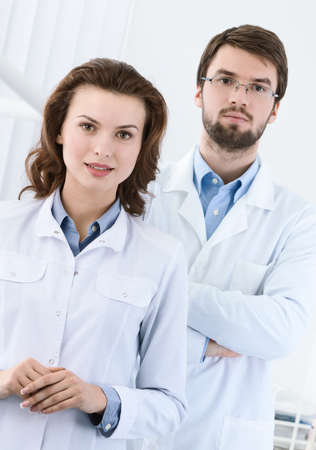 Medical staff is waiting for the patient, white background photo