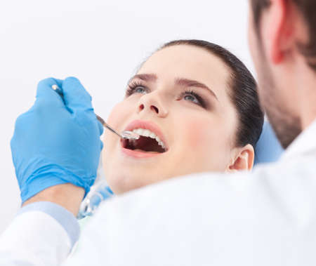 Dentist examines teeth of the patient on the dentist Stock Photo - 14729962