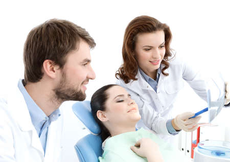 stomatologist: The patient thoroughly examines the x ray photo of the teeth  She is happy that everything is ok Stock Photo