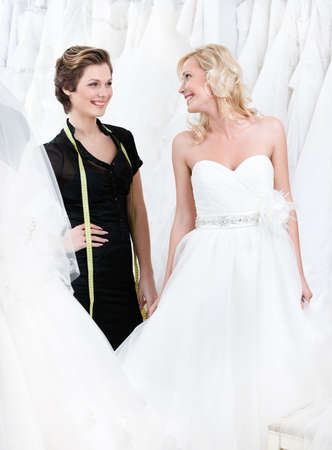 Bride is happy that the dress fits well Stock Photo - 14729945