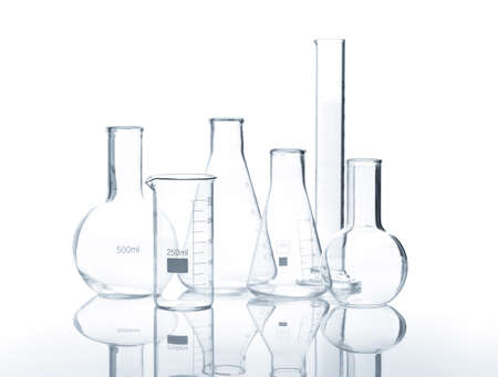 stinks: Six empty laboratory flasks with reflection on the surface of the table, isolated Stock Photo