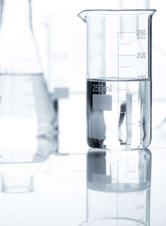 chemically: Laboratory flasks with a clear liquid, close-up view