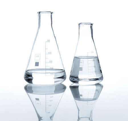 chemically: Two laboratory flasks with a clear liquid, isolated