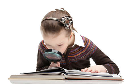 Pupil studies something with the help of magnifying glass, isolated, white background photo