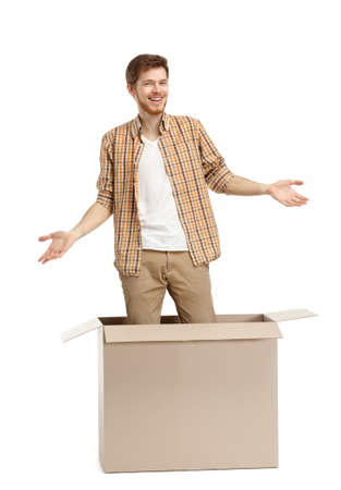 get out: Young man is surprised why he is inside the box, isolated, white background