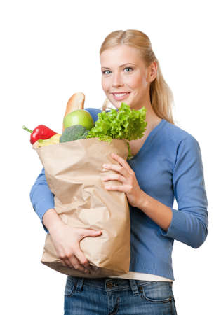 Attractive woman with a paper bag full of healthy food, isolated on white photo