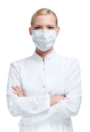 Woman doctor is in medical gown and respirator, isolated on white photo