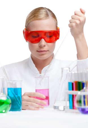 researcher: Investigator tests purple liquid in beaker, isolated on white Stock Photo