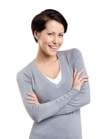 woman short hair: Smiley woman with crossed arms, isolated on white Stock Photo