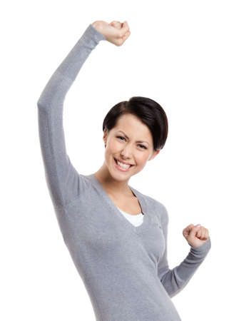 shot put: Beautiful girl gestures triumphal fists, isolated on white