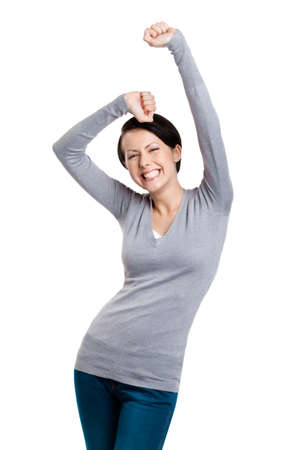 gladly: Beautiful girl gesturing triumphal fists is happy, isolated on white