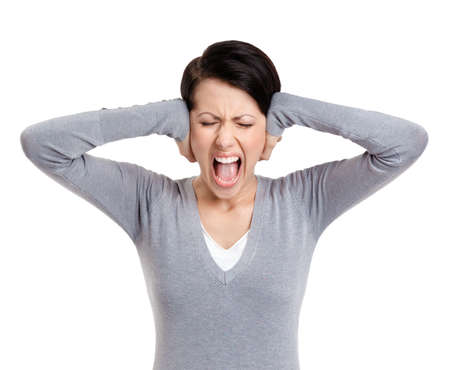 woman screaming: Closing ears with hands and screaming, isolated on white
