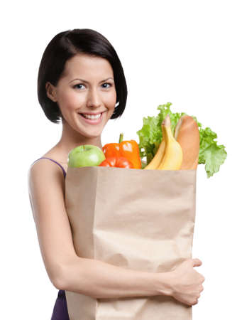 Attractive girl with the packet of fruit and vegetables, Isolated, white background. Losing weight program photo
