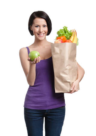 Pretty young woman with the packet full of healthy nutrition, isolated, white background photo
