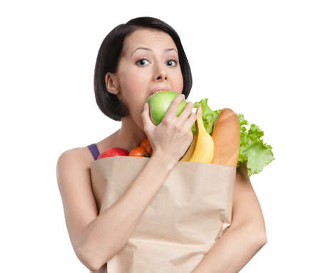Vegetarian girl eats a green apple, isolated, white background photo