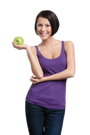 Weighting loss lady with green apple, isolated, white background photo