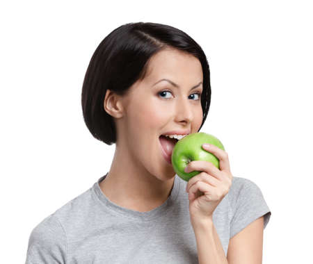 Young vegetarian lady with green apple, isolated, white background photo