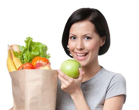 bolsa de pan: Retrato de niña comiendo una manzana, fondo blanco, blanco