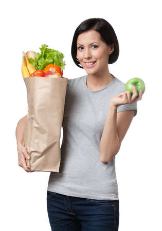 Slim woman with healthy food, isolated, white background photo