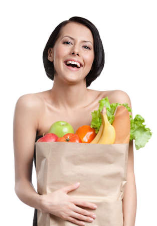 Young girl smiles handing the packet of greens, isolated, white background photo