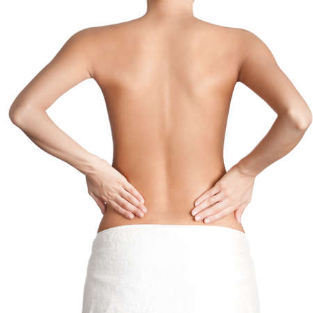 Slim waist of athletic woman, isolated, white background photo