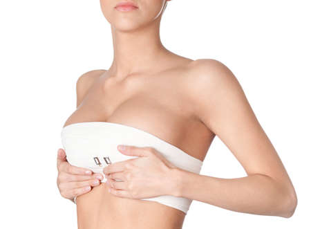 female breast: Preparing to breast correction, isolated, white background