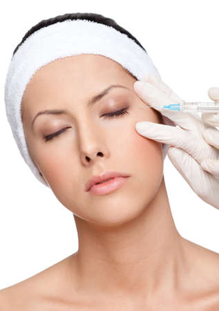 Applying botox eyelid correction, isolated, white background photo