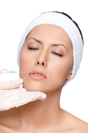 Applying botox lips correction, isolated, white background photo